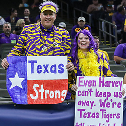 Sep 2, 2017; New Orleans, LA, USA; Thomas Irby and his wife Pamela Irby whom flew in for the game from Houston earlier today hold up a sign for support of Houston before the AdvoCare Texas Kickoff game against the Brigham Young Cougars at the Mercedes-Benz Superdome. Mandatory Credit: Derick E. Hingle-USA TODAY Sports