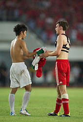 GUANGZHOU, CHINA - Wednesday, July 13, 2011: Liverpool's Jack Robinson swaps shirts with Guangdong Sunray Cave's Tan Binliang during the first pre-season friendly on day three of the club's Asia Tour at the Tianhe Stadium. (Photo by David Rawcliffe/Propaganda)