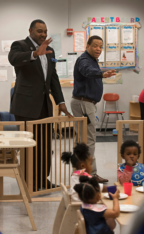 Superintendent Dr Anthony Hamlet (left) and principal Dr Bernard Taylor wave goodbye to toddles in the early childhood classroom at Westinghouse High School in December.