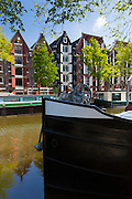 Traditional houseboat on Dutch canals,  Prinsengracht,  in Amsterdam, Holland, The Netherlands