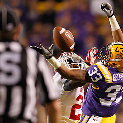 November 12, 2011; Baton Rouge, LA, USA;  Western Kentucky Hilltoppers defensive back Tyree Robinson (22) breaks up a pass intended for LSU Tigers wide receiver Odell Beckham (33) during the second quarter of a game against the Western Kentucky Hilltoppers at Tiger Stadium.  Mandatory Credit: Derick E. Hingle-US PRESSWIRE