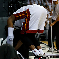 Jun 18, 2013; Miami, FL, USA; Miami Heat shooting guard Dwyane Wade (3) reacts to an apparent injury during the first quarter of game six in the 2013 NBA Finals against the San Antonio Spurs at American Airlines Arena.  Mandatory Credit: Derick E. Hingle-USA TODAY Sports
