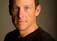 Lance Armstrong, posing in a Nike LIVESTRONG T-shirt in the basement of his bike shop, Mellow Johnny's in Austin, Texas on Dec. 10, 2008 .  © 2008 Robert Seale.  ...Robert Seale Photography.www.robertseale.com.832-654-9572
