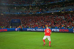 LILLE, FRANCE - Friday, July 1, 2016: Wales' Joe Ledley dances for the supporters as they celebrate after a 3-1 victory over Belgium and reaching the Semi-Final during the UEFA Euro 2016 Championship Quarter-Final match at the Stade Pierre Mauroy. (Pic by David Rawcliffe/Propaganda)