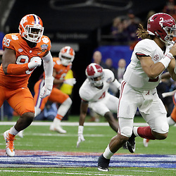 Jan 1, 2018; New Orleans, LA, USA; Alabama Crimson Tide quarterback Jalen Hurts (2) runs the ball ahead of Clemson Tigers defensive end Clelin Ferrell (99) during the second quarter in the 2018 Sugar Bowl college football playoff semifinal game at Mercedes-Benz Superdome. Mandatory Credit: Derick E. Hingle-USA TODAY Sports