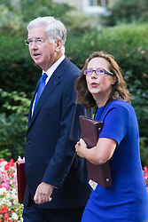 Downing Street, London, September 13th 2016. Defence Secretary Michael Fallon and Lord Privy Seal and Leader of the House of Lords Baroness Natalie Evans  arrives for the weekly cabinet meeting at Downing Street.