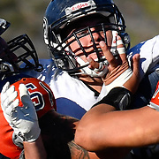 Zack Hickman and Trevon Atkinson of OCC tackle Fullerton player<br /> Orange Coast College vs Fullerton College <br /> photo by Nancy Porfirio/Shutter Diva Photography/Sports Shooter Academy 2016