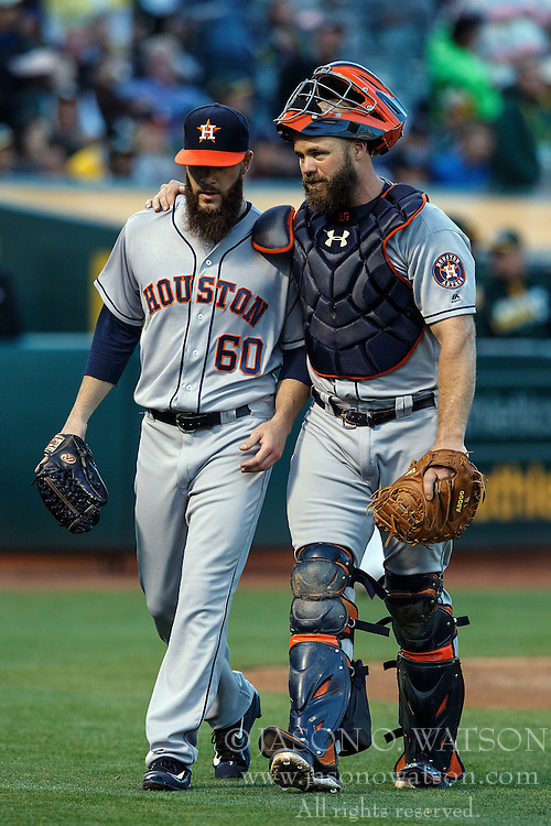 OAKLAND, CA - JULY 19:  Evan Gattis #11 of the Houston Astros talks to Dallas Keuchel #60 during the second inning against the Oakland Athletics at the Oakland Coliseum on July 19, 2016 in Oakland, California. The Oakland Athletics defeated the Houston Astros 4-3 in 10 innings.  (Photo by Jason O. Watson/Getty Images) *** Local Caption *** Evan Gattis; Dallas Keuchel