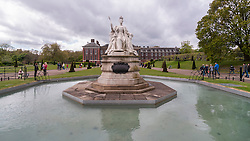 © Licensed to London News Pictures. 03/05/2015. London, UK. Well-wishers and tourists walk around the Victoria Statue outside Kensington Palace as they await news of the name for the new daughter of the Duke and Duchess of Cambridge who was born the previous day. Photo credit : Stephen Chung/LNP