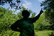 "UNIONTOWN, AL – MAY 21, 2015: Esther Calhoun, a native of Uniontown, points to the location where contaminated water from a lagoon flows into Freetown Creek. ""It's a shame this is happening,"" Calhoun said. ""If we were a bigger town people would care about what was going on. But being in the black belt, nobody cares."" Despite the prevalence of chalky clay soil throughout much of the Black Belt, spray fields have been utilized as a primary sewage treatment method. The inability of the sewage water to percolate through the soil often leads to problems of overflow and contamination of the area's water supply."