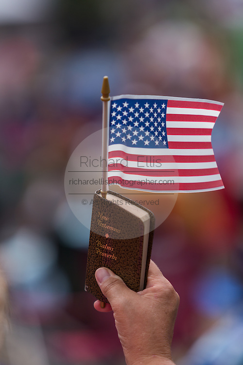 "An Evangelical Christian holds a bible and flag during the ""Stand With God"" rally  August 29, 2015 in Columbia, SC. Thousands of conservative Christians gathered at the State House to rally against gay marriage and listen to GOP presidential candidates Gov. Rick Perry and Sen. Ted Cruz speak."