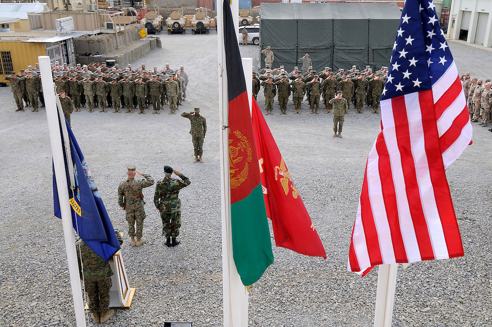 US Marine Colonel Jeff Haynes and Afghan Major General Wardak, 201 Corps Commander (bottom left), salute US Marines during the Marine Corps Birthday ceremony at Camp Black Horse Afghanistan.