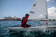World Sailing Emerging Nations Program - Boca Chica Sailing Club, Santo Domingo 08/19/2017 - DAY 1- Oscar perez from Cuba sails in front of the Caucedo multimodal industrial port near the clinic venue
