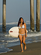 Woman In Bikini At The Huntington Beach Pier With Surf Board