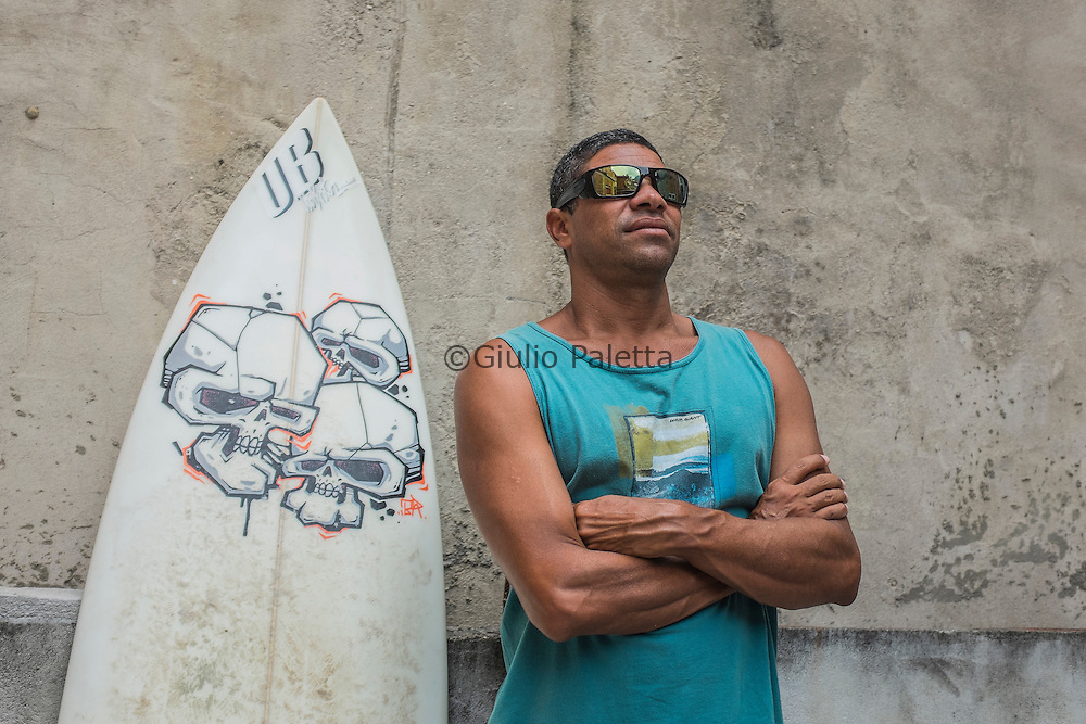 """Gilson Barreto, 46. He started surfing in São Conrado when He was 12. He is one of the first surfers of Rocinha's slum. When He started surfing, he said, """"there were good waves all day long"""", and he used to spend the whole day at the beach"""