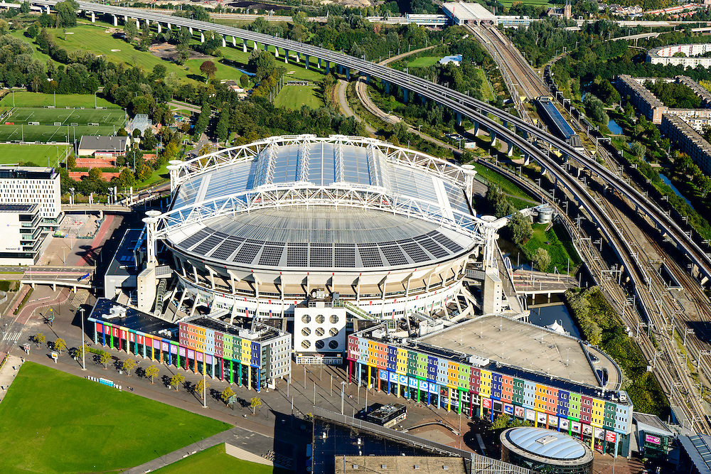 Nederland, Noord-Holland, Amsterdam, 27-09-2015; Amsterdam Zuidoost, Arenagebied met Ajax Stadion  stadion Arena en winkelgebied rond Arena Boulevard en Heineken Music Hall. Rechtsonder station Bijlmer Amsterdam Arena. In de achtergrond station Duivendrecht en de Utrecht boog.<br /> Football stadion Arena of Ajax in Amsterdam-South-east, with shopping mall and concert hall.<br /> luchtfoto (toeslag op standard tarieven);<br /> aerial photo (additional fee required);<br /> copyright foto/photo Siebe Swart