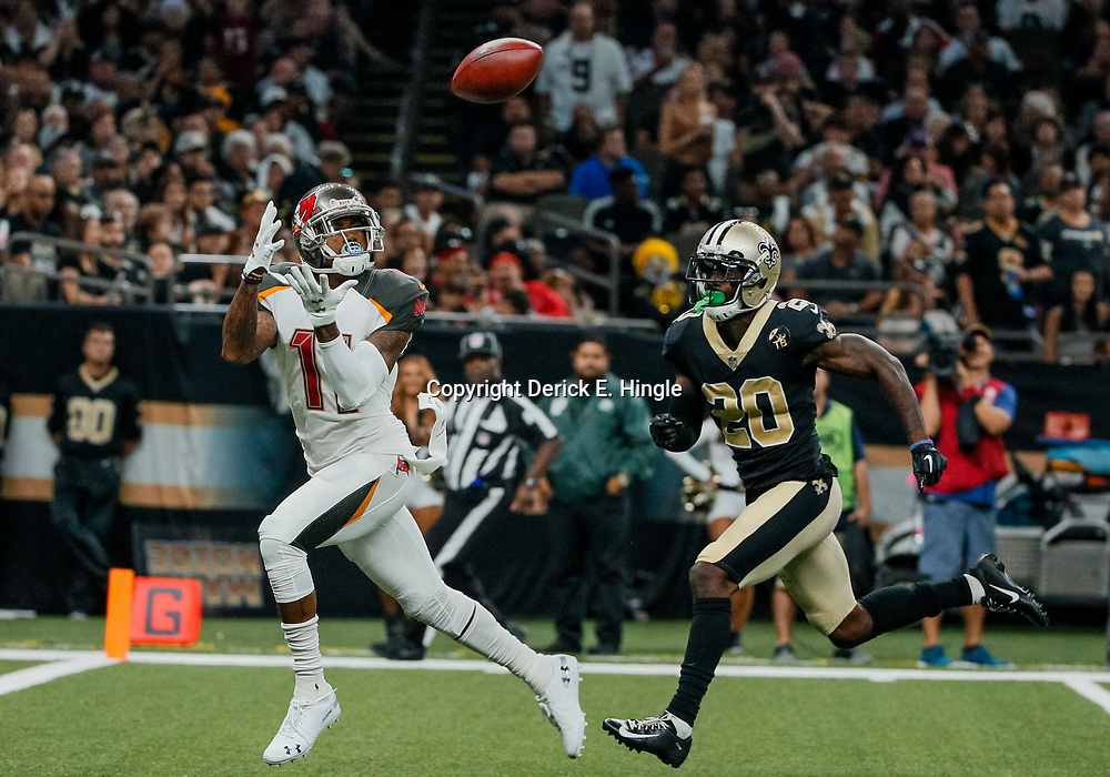 Sep 9, 2018; New Orleans, LA, USA; Tampa Bay Buccaneers wide receiver DeSean Jackson (11)  catches a touchdown over New Orleans Saints cornerback Ken Crawley (20) during the fourth quarter of a game at the Mercedes-Benz Superdome. The Buccaneers defeated the Saints 48-40. Mandatory Credit: Derick E. Hingle-USA TODAY Sports