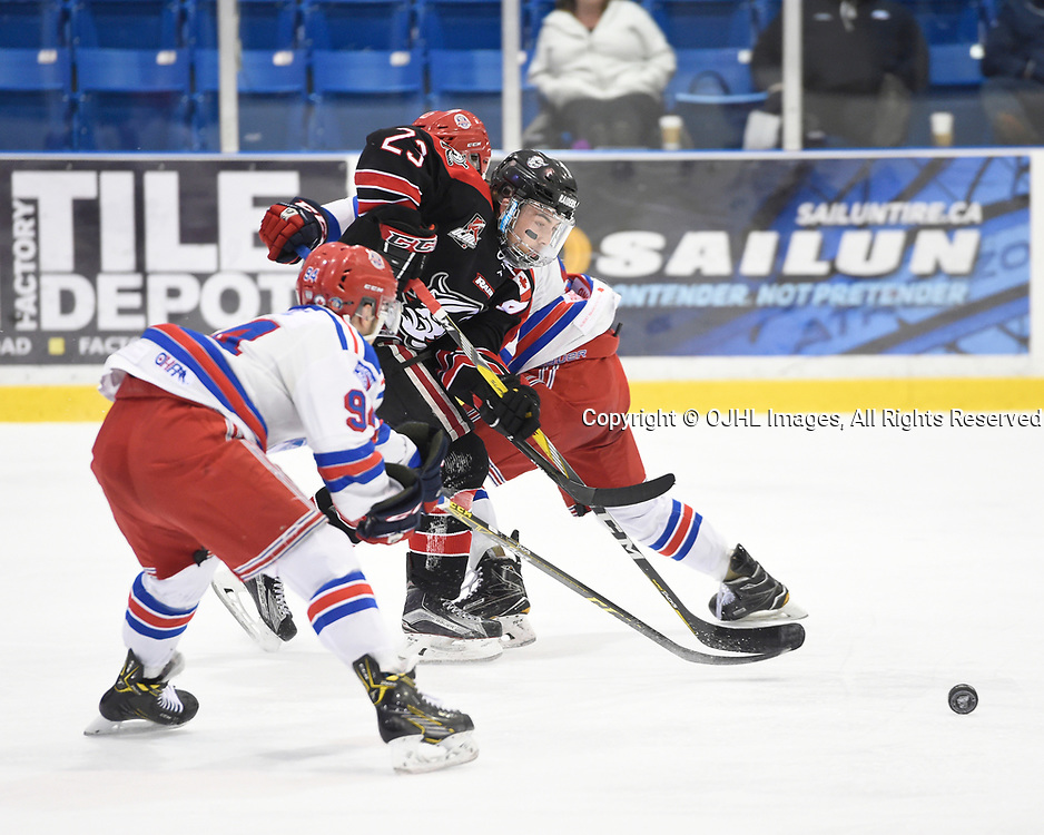 OAKVILLE, ON - APR 3,  2017: Ontario Junior Hockey League, South West Conference Championship game between Oakville Blades and the Georgetown Raiders, Jack Jacome #23 of the Georgetown Raiders battles for the puck during the second period.<br /> (Photo by Andy Corneau / OJHL Images)
