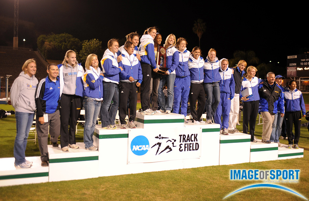 May 24, 2008; Walnut, CA, USA; The UC San Diego women and coach Tony Salerno pose on the awards podium after finishing fourth in the NCAA Division II Track & Field Championships at Mt. San Antonio College's Hilmer Lodge Stadium.
