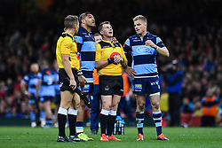 27th April 2019 , Principality Stadium , Cardiff, Wales ; Guinness pro 14's, Round 21, Cardiff Blues Vs Ospreys ; Nick Williams and Gareth Anscombe of Cardiff Blues try to convince Referee Nigel Owens it was a try<br /> <br /> Credit :  Craig Thomas/Replay Images