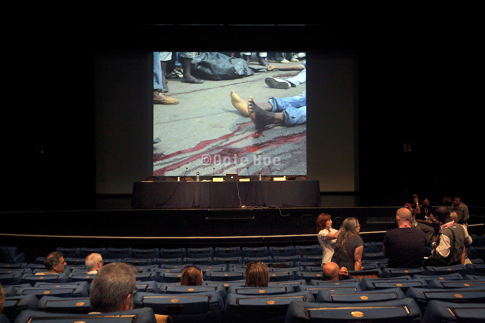 before a lecture on photo journalism in the Ivory Coast at Visa pour L'image September 2011