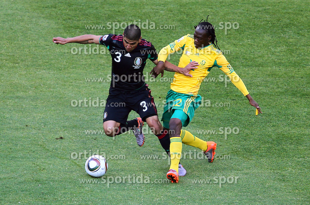 Mexico's Carlos Salcido vs South Africa's  Siboniso Gaxa during the Group A first round 2010 FIFA World Cup South Africa match between South Africa and Mexico at Soccer City Stadium on June 11, 2010 in Johannesburg, South Africa.  (Photo by Vid Ponikvar / Sportida)