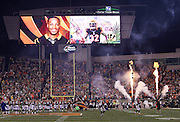 Photographs of Cincinnati Bengals running back Jeremy Hill (32) are shown on the Paul Brown Stadium scoreboard in this general view, wide angle photograph of the stadium interior taken during pregame player introductions with a smoke and fire display used before the Cincinnati Bengals NFL AFC Wild Card playoff football game against the Pittsburgh Steelers on Saturday, Jan. 9, 2016 in Cincinnati. The Steelers won the game 18-16. (©Paul Anthony Spinelli)