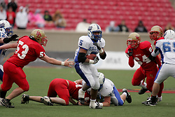 Bullitt East hosted Bell County in the Class 4A KHSAA Commonwealth Gridiron Bowl on Saturday, Dec. 13, 2008, at Papa John's Cardinal Stadium in Louisville, Ky. Bell County's Dominic Carton, center, is pursued by myriad Bullitt East defenders. (photo by Jonathan Palmer)