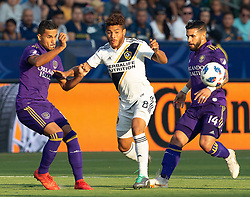 July 29, 2018 - Carson, California, U.S - Jonathan dos Santos #8 of the LA Galaxy dribbles in between defenders during their game with the Orlando City on Sunday July 29, 2018 at StubHub Center in Carson, California. LA Galaxy defeats Orlando City, 4-3. (Credit Image: © Prensa Internacional via ZUMA Wire)