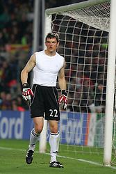 Bayern Munich´s goalkeeper Hans Jörg Butt loses his shirt during the UEFA Champions League quarter final first leg match between FC Barcelona and FC Bayern Munich at the Camp Nou stadium on April 8, 2009 in Barcelona, Spain.