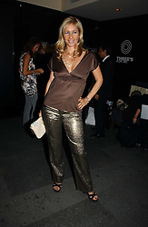 TANIA BRYER at a party to launch Three's A Crowd held at the Mayfair Hotel, Berkley Street, London on 5th December 2006.<br />