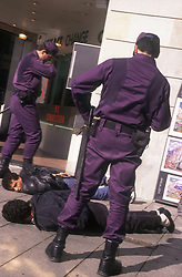 Police officers making arrests on Barcelona street,