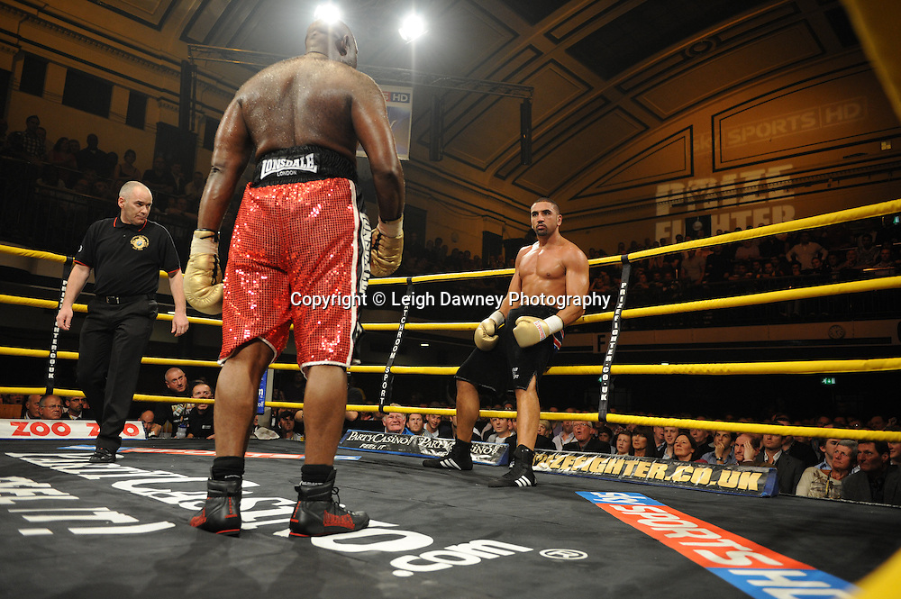 Matt Skelton (red shorts) defeats Ali Adams at Prizefighter The Heavyweights 9th Ocrtober 2010 at York Hall, Bethnal Green, London. Prizefighter/Matchroom Sport. Barry & Eddie Hearn © Photo credit: Leigh Dawney