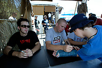 Jul 01, 2003; Anaheim, California, USA; Moto X star athletes ROBERT DISTLER (L) &amp; CHUCK CAROTHERS (R) sign autographs after their show at the opening of Disney's California Adventure &quot;X Games Experience&quot;.  Disney park has built two X-Arena's specifically for this 41 day event highlighting extreme sports for the launch of the 2003 ESPN X Games.<br />