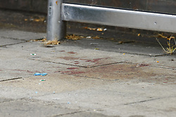 © Licensed to London News Pictures. 10/06/2020. Leatherhead, UK. Blood and broken glass can be seen at a bus stop in Leatherhead, Surrey after a body was found nearby. Officers were called to North Street in Leatherhead shortly after 6am this morning following the discovery of a man's body. Enquiries are ongoing at a number of locations in the area. Local reports say that the body may have been found in a block of flats off the High Street. Photo credit: Peter Macdiarmid/LNP