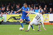 AFC Wimbledon defender Darius Charles (32) dribbling and taking on Northampton Town midfielder Matthew (Matt) Taylor (31) during the EFL Sky Bet League 1 match between AFC Wimbledon and Northampton Town at the Cherry Red Records Stadium, Kingston, England on 11 March 2017. Photo by Matthew Redman.