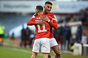 Conor Chaplin of Barnsley FC and Jacob Brown of Barnsley FC celebrating their team's second goal during the EFL Sky Bet Championship match between Barnsley and Queens Park Rangers at Oakwell, Barnsley, England on 14 December 2019.