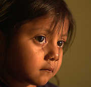 A 4-year-old girl who was smuggled into the United States from Mexico illegally waits at the Mexican Consulate in Tucson, Arizona, USA, to be reunited with family.  She and her two siblings were discovered by law enforcement in the trunk of a smuggler's vehicle in temperatures exceeding 100 degrees.