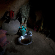 Kitchen utensils are seen in the floor of a improvised home in a cave of the mountains outside Buram village in South Kordofan's Nuba Mountains.