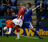 Photo: Steve Bond/Sportsbeat Images.<br />Leicester City v Charlton Athletic. Coca Cola Championship. 29/12/2007. Chris Iwelumo (L) shields the ball from Gareth McAuley (R)