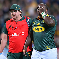 Trevor Nyakane of South Africa is helped off the field by medical staff after an eye injury