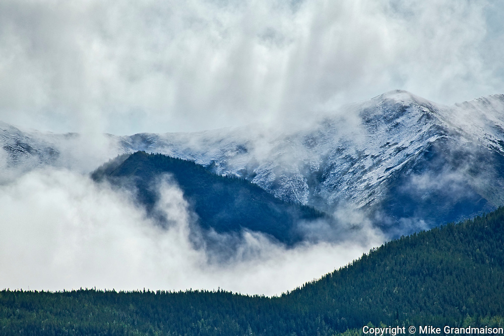 Peaks of the Northern Rocky Mountains in cloud<br />Liard River Hot Springs Provincial Park<br />British Columbia<br />Canada