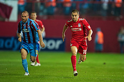 TRABZON, TURKEY - Thursday, August 26, 2010: Liverpool's Joe Cole in action against Trabzonspor during the UEFA Europa League Play-Off 2nd Leg match at the Huseyin Avni Aker Stadium. (Pic by: David Rawcliffe/Propaganda)