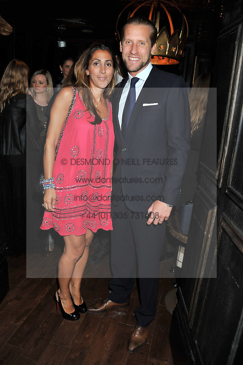 JAKE PARKINSON-SMITH and his wife SAMIRA at the launch of the Johnnie Walker Blue Label Club held at The Scotch, Mason's Yard, London on 1st May 2012.