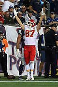 Kansas City Chiefs tight end Travis Kelce (87) raises his arms in celebration after the Chiefs score a late fourth quarter touchdown good for a 35-27 lead during the 2017 NFL week 1 regular season football game against the New England Patriots, Thursday, Sept. 7, 2017 in Foxborough, Mass. The Chiefs won the game 42-27. (©Paul Anthony Spinelli)