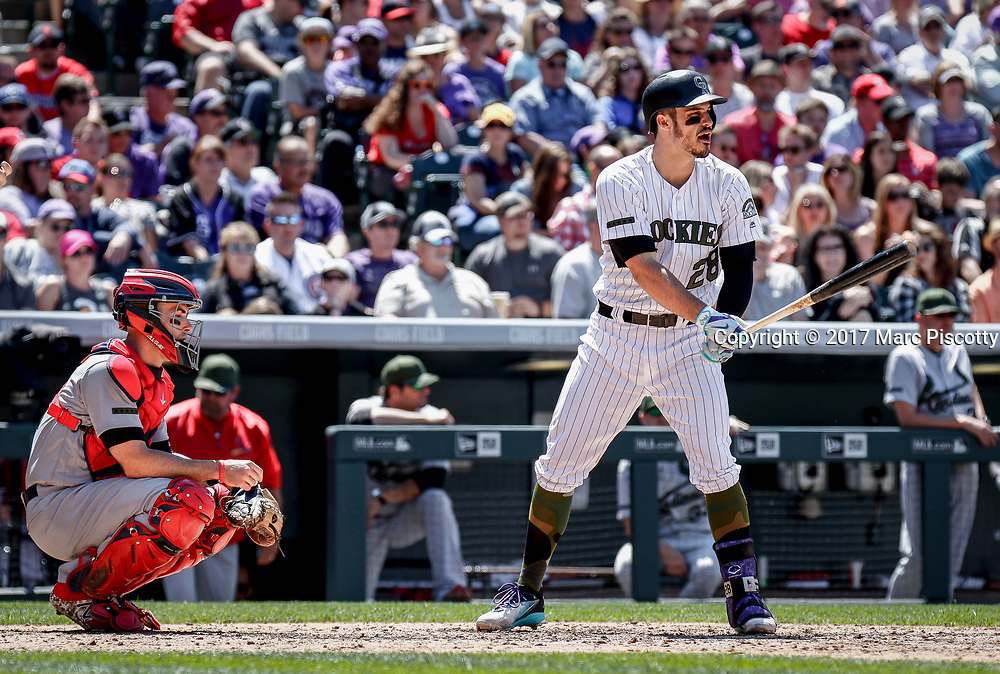 SHOT 5/28/17 1:38:00 PM - The Colorado Rockies Nolan Arenado #28 prepares to hit against the St. Louis Cardinals  during their regular season MLB game at Coors Field in Denver, Co. The Rockies won the game 8-4. (Photo by Marc Piscotty / © 2017)