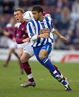 Fotball<br /> Skottland 2004/2005<br /> Foto: SBI/Digitalsport<br /> NORWAY ONLY<br /> <br /> Hearts v Kilmarnock, Scottish Cup fourth round, Tynecastle Park, Edinburgh. 05/02/2005<br /> <br /> Lee Miller runs past Liam Fontaine
