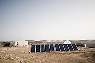 Palestine 2010. Palestinian farmers in a tents village with solar panels. South Hebron's Hills.