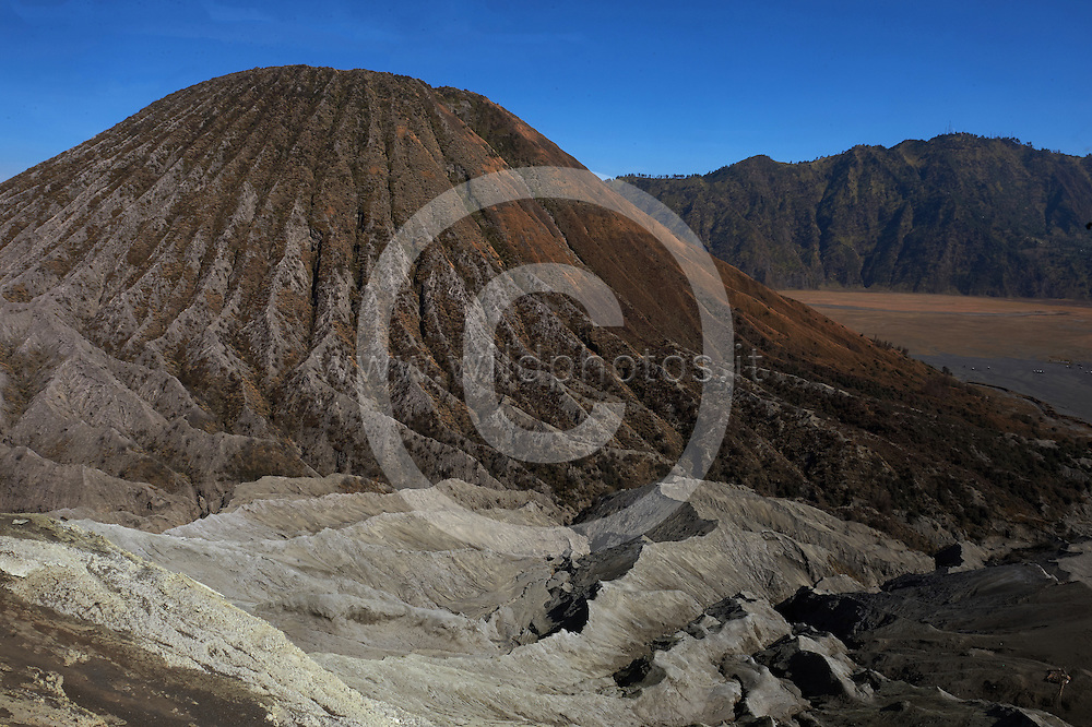 Mount Bromo (Indonesian: Gunung Bromo), is an active volcano and part of the Tengger massif, in East Java, Indonesia. At 2,329 metres (7,641 ft) it is not the highest peak of the massif, but is the most well known. The massif area is one of the most visited tourist attractions in East Java, Indonesia. The volcano belongs to the Bromo Tengger Semeru National Park. The name of Bromo derived from Javanese pronunciation of Brahma, the Hindu creator god.