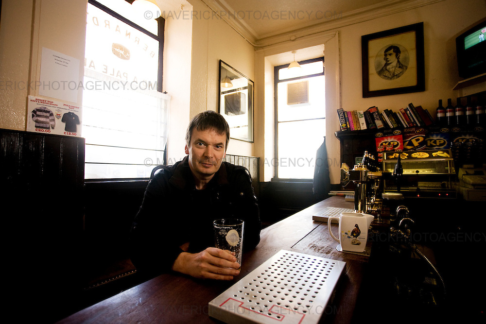 Ian Rankin, Scottish author and creator of the Inspector Rebus novels drinks a beer at the 'Oxford Bar' The bar was made famous as it is the place where character Inspector Rebus drinks..Picture Michael Hughes/Maverick